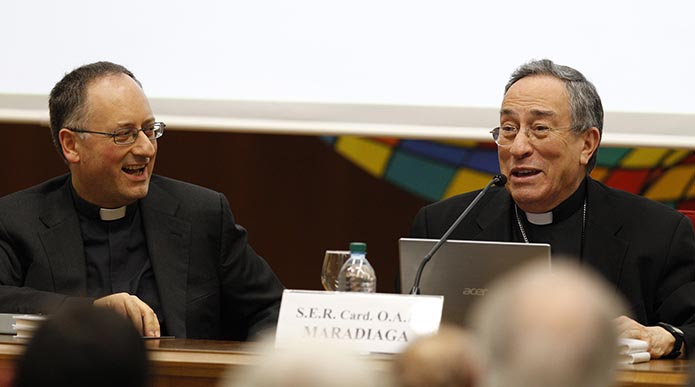 Jesuit Father Spadaro looks on as Honduran Cardinal Rodriguez Maradiaga speaks during presentation of book about Pope Francis at Vatican