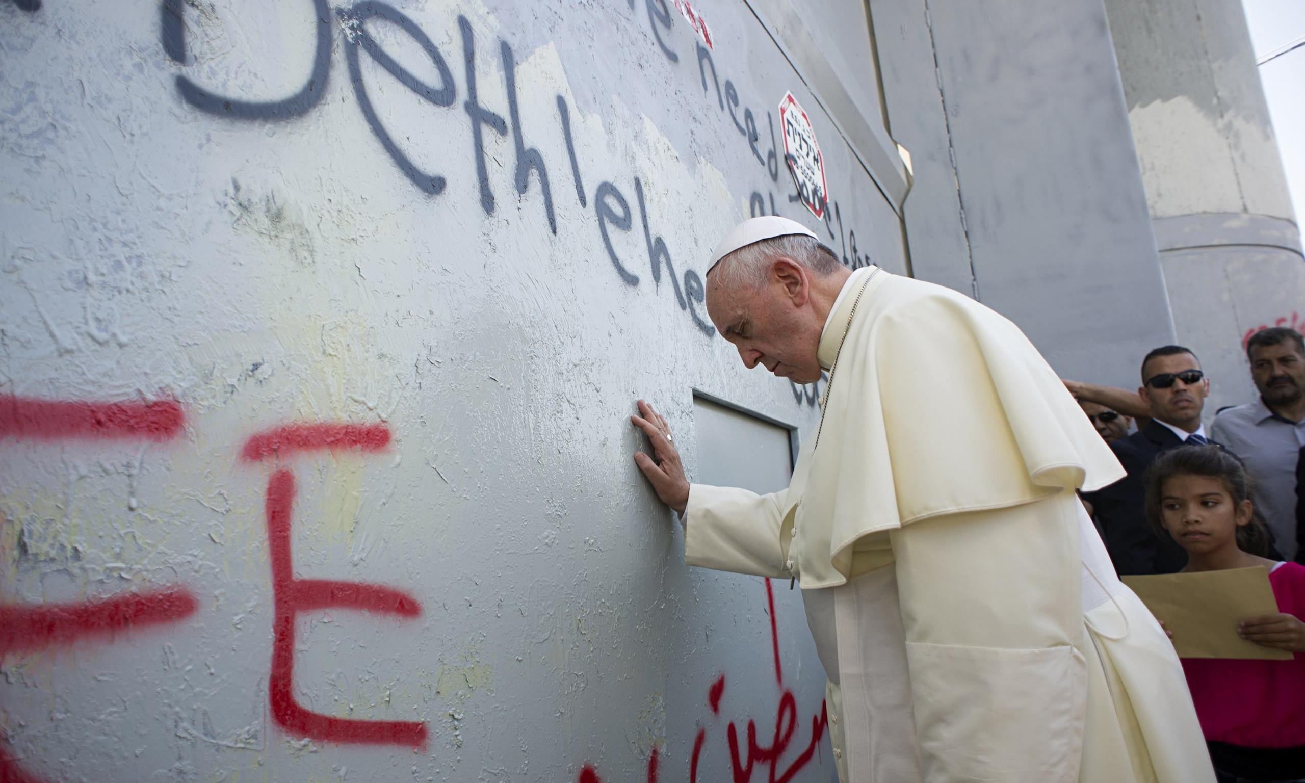 Pope Francis touches wall in Bethlehem
